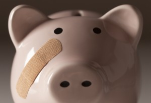 2221734-piggy-bank-with-bandage-on-face